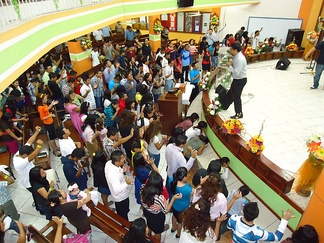 Pentecostals pray in tongues at an Assemblies of God church in Cancún, Mexico