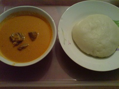 A plate of fufu accompanied with peanut soup
