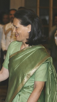 Sonia Gandhi in a professional sari with extended blouse.