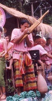 Khaen player in a sarong and pakama.