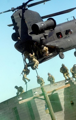 Rangers practice fast roping techniques from an MH-47 during an exercise at Fort Bragg