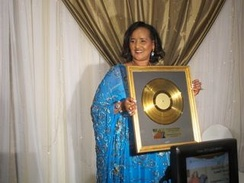Somali singer Saado Ali Warsame receiving a gold record Lifetime Achievement Award