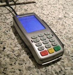 When using this credit card terminal, a VISA cardholder swipes or inserts their credit card, and enters their PIN on the keypad