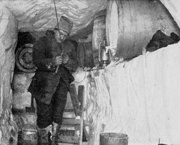 Sverre Hassel in the oil store at Framheim during the winter of 1911