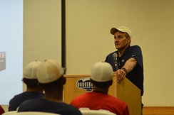 Joe Torre speaks to the athletes