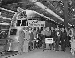 "The passengers, including ""Zeph"" the burro, that rode the Zephyr on the ""Dawn-to-Dusk Dash"" gather for a group photo in front of the train after arriving in Chicago on May 26, 1934."