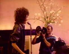 "Houston in the music video for ""You Give Good Love"", tells the story of a romance with a cameraman."