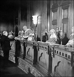 King becomes the first person to take the Oath of Citizenship, from Chief Justice Thibaudeau Rinfret, in the Supreme Court, January 3, 1947