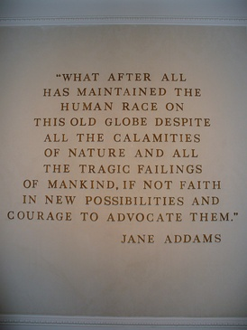 A wall-mounted quote by Jane Addams in The American Adventure (Epcot) in the World Showcase pavilion of Walt Disney World's Epcot.