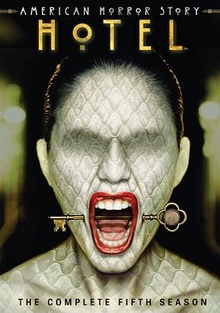 DVD cover art for AHS Hotel, showing a woman screaming with a key stuck from her cheeks.