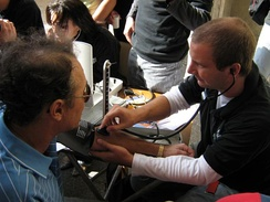 Medical Student taking blood pressure during an event organised by the local medical student association