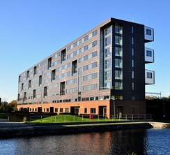 Pooley House, the largest campus building, on the edge of Regent's Canal
