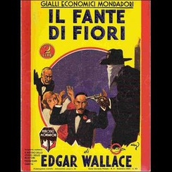 Mondadori's 1933 translation of Edgar Wallace's 1920 novel Jack O' Judgement (rendered in Italian as Il Fante di Fiori, The Jack of Clubs), with the characteristic yellow background and the figure of a masked killer.