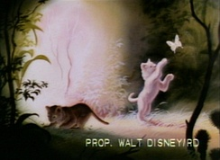 Screenshot from an early presentation reel of The Lion King that shows a white lion cub and a butterfly.