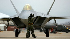 F-22A from the 1st Fighter Wing, 27th Fighter Squadron, Langley AFB, Virginia being guided into place on the flightline