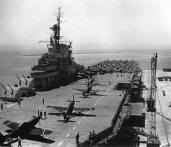The United States Navy aircraft carrier USS Boxer (CV-21) brings aboard 146 U.S. Air Force F-51 Mustangs at Naval Air Station Alameda, California, for transportation to East Asia in July 1950 during the early days of the Korean War.