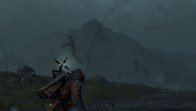 Pre-release gameplay screenshot of Death Stranding, taken from the trailer shown at E3 2018. Sam, the protagonist, uses a device to uncover several invisible enemies in order to sneak past them.