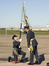 The 2622sqn RAuxAF Regiment standard is presented to an officer on 30 September 2006