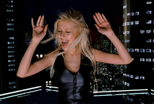 Christina Aguilera singing on a CGI rooftop in the music video.
