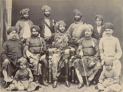 The Nawab of Junagarh Bahadur Khan III (seated centre in an ornate chair) shown in an 1885 photograph with state officials and family.
