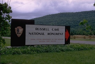 Entrance to Russell Cave National Monument with old entrance sign