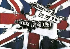 A poster for the rock band The Sex Pistols. The poster depicts the Union Jack flag with rips and safety pins through it.