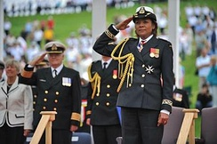 Then-Governor General Michaëlle Jean acting as Commander-in-Chief of the Canadian Forces and wearing the naval uniform while presenting the newly consecrated queen's colour to Maritime Command, 27 June 2009