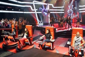 The Voice of the Philippines' coaches (from left to right): Bamboo Mañalac, Sarah Geronimo, Lea Salonga, and apl.de.ap sitting on their respective red chairs during the blind auditions held at ABS-CBN's Studio 2.