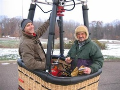 Hot air balloon pilot and passenger in basket