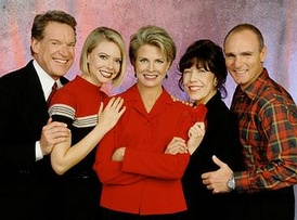 The cast of Murphy Brown for its final two seasons. Lily Tomlin is pictured fourth from the left.