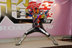Kamen Rider Den-O's Super Climax Form debuts in this film, seen here at a pre-release press conference.