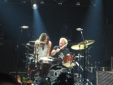 Steven Tyler and Joey Kramer playing drums together at an Aerosmith concert in Chicago, Illinois on June 22, 2012