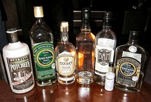 A Selection of Legal Irish and Celtic Poitin or Poteen Bottles Taken in a Poitin Bar.jpg
