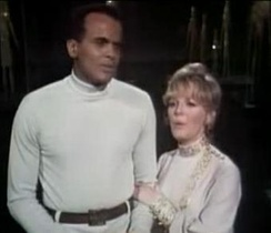 Clark holding Belafonte's arm, the first scene of physical contact between a black man and a white woman to appear on US television, April 1968