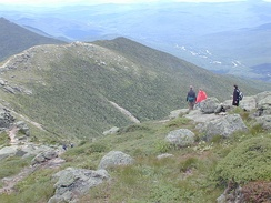 Hikers traversing the Franconia Ridge in the White Mountains of New Hampshire, much of which is in the alpine zone.