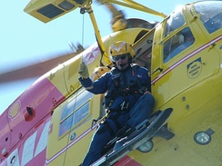 A rescue air crewman aboard Westpac Life Saver Rescue Helicopter Service Lifesaver 1 in action.