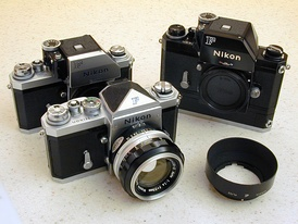Foreground: Nikon F with eyelevel prism; Nikon F with FTn Photomic prism; Nikon F with FTn Photomic prism and F36 motor drive