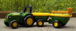 This toy tractor also works as an advertisement for John Deere.