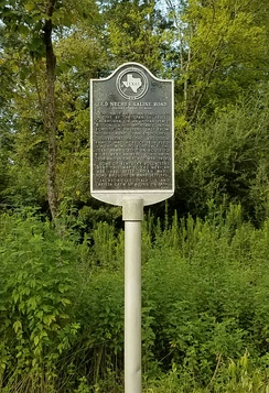 Old Neches Saline Road, which predated US 175, is remembered with a state Historical Marker at this spot northwest of Jacksonville.
