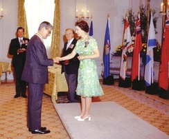 Elizabeth II, Queen of Canada and Sovereign of the Order of Canada, invests Jules Léger as a Companion of the order at Rideau Hall, August 1973