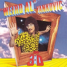 "The cover for ""Weird Al"" Yankovic in 3-D shows ""Weird Al"" Yankovic protruding out of an askew box with a wooden frame. The title is written in mock three-deminsional font."