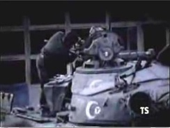 An Armenian engineer repairing a captured Azerbaijani tank. Note the crescent emblem on the turret of the tank.