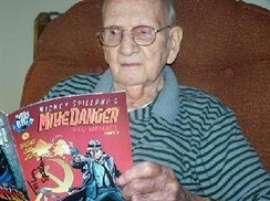 Gill in his later years, holding a copy of Mike Danger