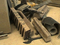 The foreground tool with serrated blades is a stonemason's  French drag, used on soft limestone