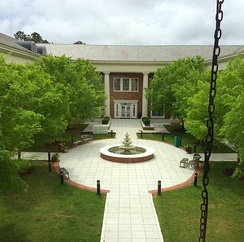 The fountain and courtyard of the Thomas W. and Robin W. Edwards College of Humanities and Fine Arts.