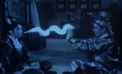 Scene from the wuxia film Buddha's Palm (1964). The magic qi rays are created using crude hand-drawn animation.