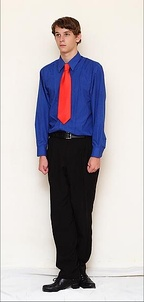 A boy's costume. It may vary from a simple shirt and tie to waistjackets.