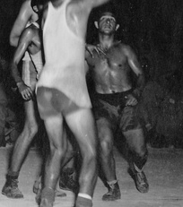 Basketball player Mel Hirsch during WWII playing on the U.S. Army Air Corps 13th Troop Carrier Squadron's officers team against the enlisted men for the 403rd Group Championship, on Biak Island, April 9, 1945.