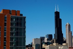 UIC's James Stukel Towers residence hall with downtown Chicago and Willis Tower in the background