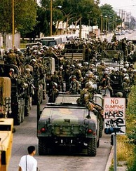 Marines disembark in Compton from their Humvees and trucks on May 2, 1992